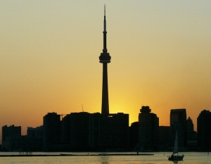 CN TOWER SILHOUETTED WITH TORONTO SKYLINE AS POWER OUTAGE HIT ONTARIO.